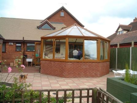 Victorian Conservatories - Large Light Oak Effect Three Facet Victorian Conservatory