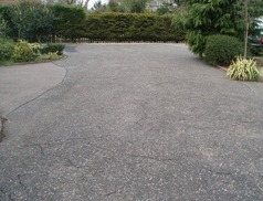 Restoration & Refurbishment of Tarmacadam - Worn Out Tarmacadam Driveway before being treated with Tarmaseal™