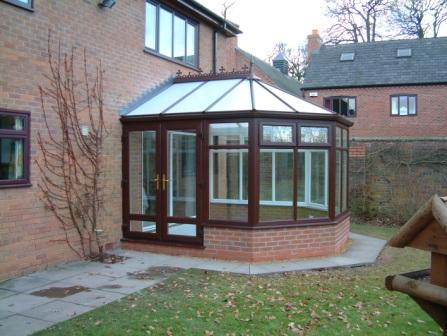 Victorian Conservatories - Rosewood Effect Three Facet Victorian Conservatory