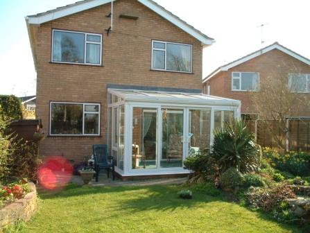 Sun Lounge Conservatories - White uPVC Conservatory with Four Part Sliding Patio Doors