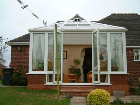 Edwardian Conservatories - White PVCu Edwardian conservatory on a dormer bungalow