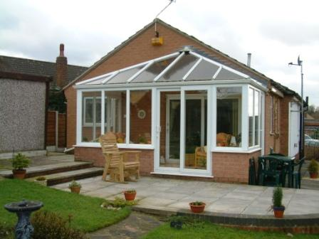 White PVCu Edwardian conservatory with uPVC sliding patio doors