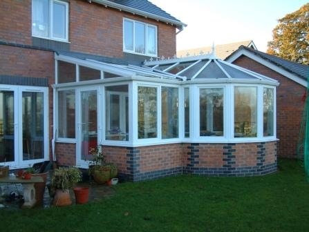 Combination Conservatories - White PVCu P Shaped Conservatory with Blue Bonded Bricks