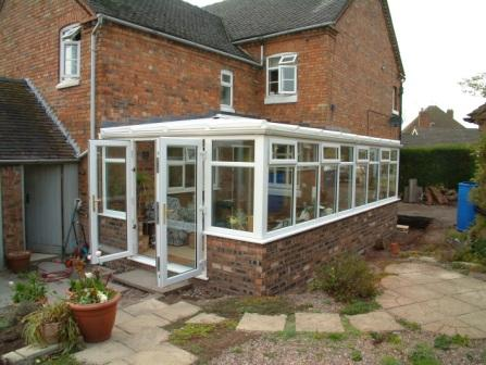 Sun Lounge Conservatories - White uPVC Sun Lounge Conservatories with Hipped End