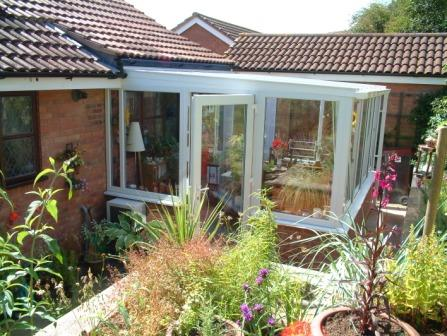 Sun Lounge Conservatories - White uPVC Sun Lounge with Low Pitched Roof
