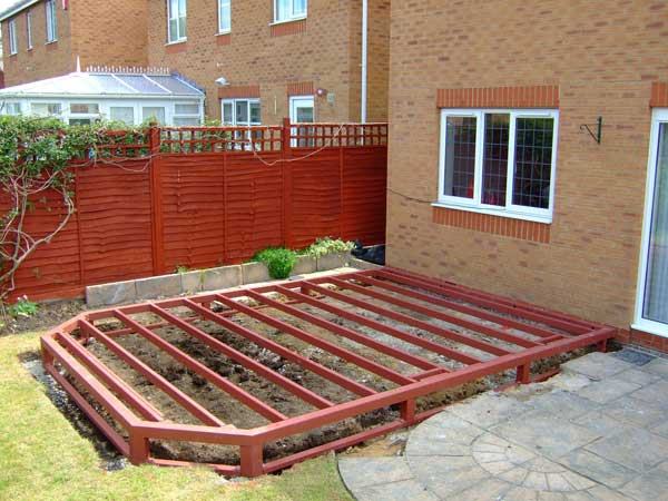 DIY Conservatories - The steel base is fixed together, positioned on the concrete pads and levelled with adjustable legs