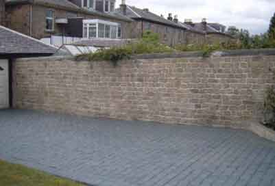 Vertical Wall Overlay with a Pattern Imprinted Concrete Driveway