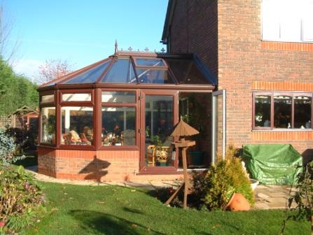 Ten Things to Consider about Conservatories - Five Facet Victorian Conservatory, Mahogany Effect uPVC