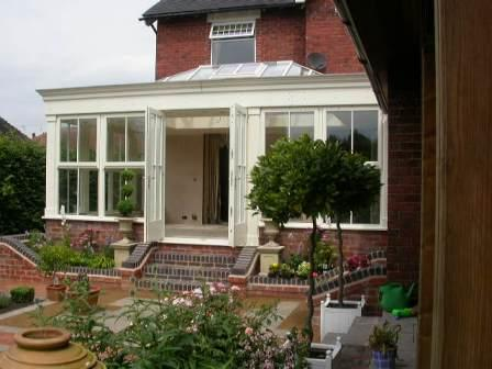 Orangeries - White Orangery with Steps Down to the Garden