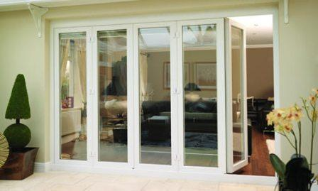 White PVCu Bi-fold doors, one section open